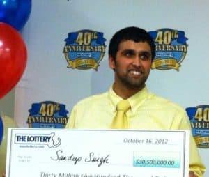 Indian Mega Millions winner Sandeep Singh with check