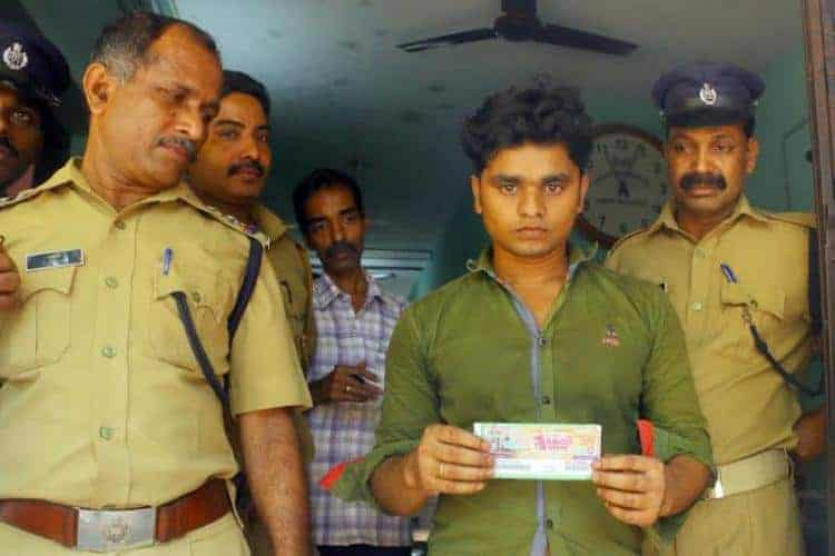kerala lottery winner with his winning lottery ticket