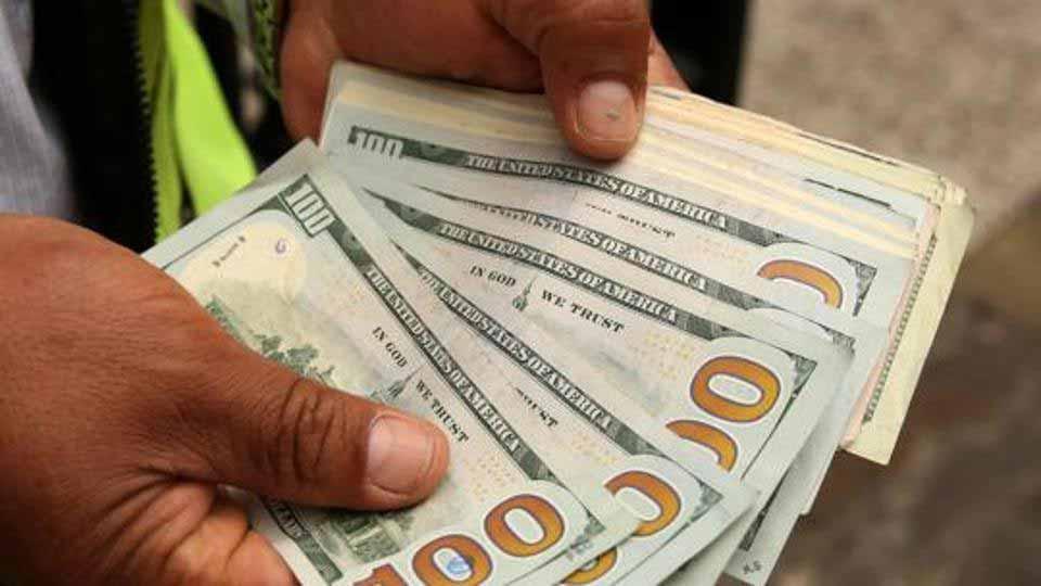 dollar bills in hands